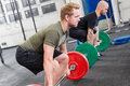 Two dedicated men trains deadlift at fitness gym center Royalty Free Stock Photo