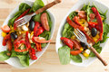 Two delicious bowls of baby spinach salad and cayenne or chili pepper served as individual appetizers or accompaniments to a Royalty Free Stock Photo