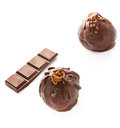 Two delicious dark chocolate candies isolated on a white backgro and bar background closeup Stock Image