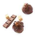 Two delicious dark chocolate candies isolated on a white backgro liqueur background closeup Royalty Free Stock Photos