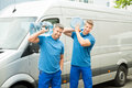 Two Delivery Men Delivering Bottles Of Water Royalty Free Stock Photo