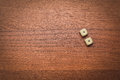 Two dice number double one on the wooden table Royalty Free Stock Photo