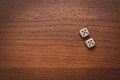 Two dice number double on the wooden table Royalty Free Stock Photography
