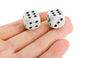 Two dices in hand isolated on white background Stock Photos