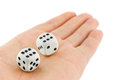 Two dices in hand isolated on white background Royalty Free Stock Images