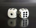 Two dices over black background Royalty Free Stock Photo
