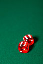 Two dices on the poker table Stock Image
