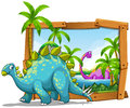 Two dinosaurs in wooden frame