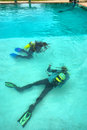 Two divers in training pool shot sodwana bay kwazulu natal province southern mozambique area south africa Stock Image