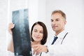 Two doctors looking at x ray healthcare medical and radiology concept Stock Photo
