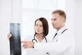 Two doctors looking at x ray healthcare medical and radiology concept Royalty Free Stock Photos