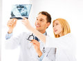 Two doctors looking at x ray picture of Stock Images