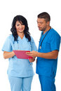 Two doctors reading clipboard Stock Image