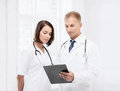 Two doctors writing prescription healthcare and medical concept Stock Images