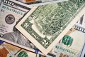 Two dollars on banknotes worth one hundred dollars, the new American bill Royalty Free Stock Photo