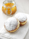 Two donuts with orange jam and sugar Royalty Free Stock Photo