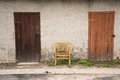 Two doors and chair a against the wall Royalty Free Stock Photography