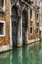 Two doors over the water in venice a chanel old building are almost Royalty Free Stock Images