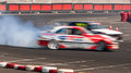 Two drift cars motion blur Royalty Free Stock Photo