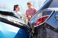 Two drivers exchange insurance details after accident car Royalty Free Stock Photos