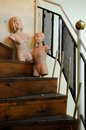 Two dummies on a staircase steep featuring one male and one female strange old railing included Royalty Free Stock Photography