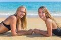 Two dutch girls lying on beach Royalty Free Stock Photo