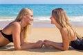 Two dutch girls lying opposite on beach Royalty Free Stock Photo