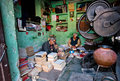 Two elderly workers repairing old books in a workshop Royalty Free Stock Photo