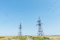 Two electrical tower and blue sky Royalty Free Stock Photo