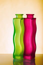 Two elegant green and red vases on a yellow background close up Royalty Free Stock Images