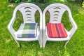 Two empty chairs plastic in the garden Stock Photos