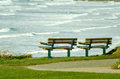Two Empty Park Benches Looking at Sea View Royalty Free Stock Photo
