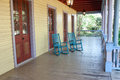 Two empty rocking chairs on a big porch Royalty Free Stock Photography