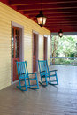 Two empty rocking chairs on a big porch Stock Photo