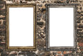 Two empty wooden frames over ruined brick wall Stock Photo