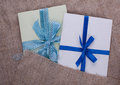 Two envelope sacking tied with ribbon Stock Photos