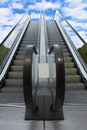 Two escalatorsleading from earth to heaven Royalty Free Stock Photo