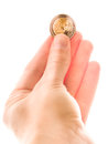 Two euros fingers holding a euro coin for your financial bonus cashback gifts and presents copy note that the coin is real and Royalty Free Stock Photo