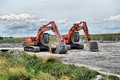 Two excavators on site in france Royalty Free Stock Photo