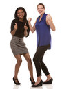 Two excited business women wearing office outfits on white isolated background Stock Images