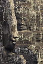Two faces carved in the walls of Angkor Wat Stock Image
