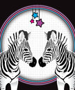 Two facing zebras against spotted neon film background