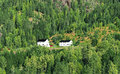 Two farmhouses on a hillside in forrest Stock Images