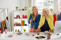 Two fashion designers at their office happy Royalty Free Stock Photography