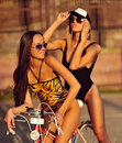 Two fashion female models posing outdoor Royalty Free Stock Photo