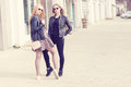 Two fashion styled friends in outdoor shooting Royalty Free Stock Photo