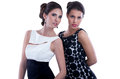 Two fashion women posing trendy dresses isolated on white background Royalty Free Stock Photography
