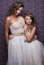 Two fashionable models young women and girl in exclusive dresses Royalty Free Stock Photography