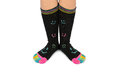 Two feet in happy socks with toes black colorful smileys the are colorful smileys too above they are striped different Royalty Free Stock Photography