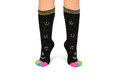 Two feet in happy socks with toes black colorful smileys the are colorful smileys too above they are striped different Royalty Free Stock Image